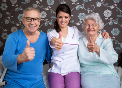 Smiling elderly people with nurse
